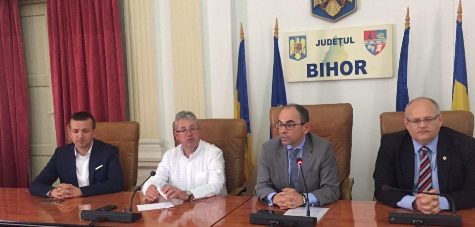 Stații de încărcare a mașinilor electrice în toate orașele Bihorului: promisiunea autorităților în fața CEO-ului Grupului Renault România